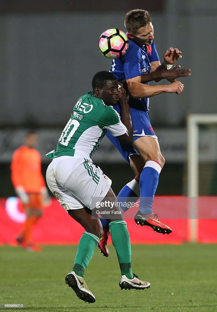 Slavia PrahaÕs forward Milan Skoda with Rio Ave FCÕs midfielder Alhassan Wakaso in action during the UEFA Europa League Qualifications Semi-Finals 2nd Leg match between Rio Ave FC and Slavia Praha at Estadio dos Arcos on August 4, 2016 in Povoa de Varzim, Portugal.
