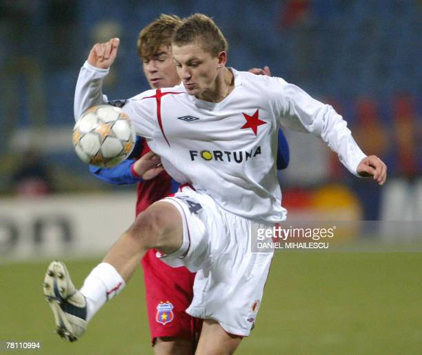 Slavia Praha's Necid Tomas vies for the ball with Steaua Bucharest's Bicfalvi Eric during the Group H Champions League football match at Ghencea...