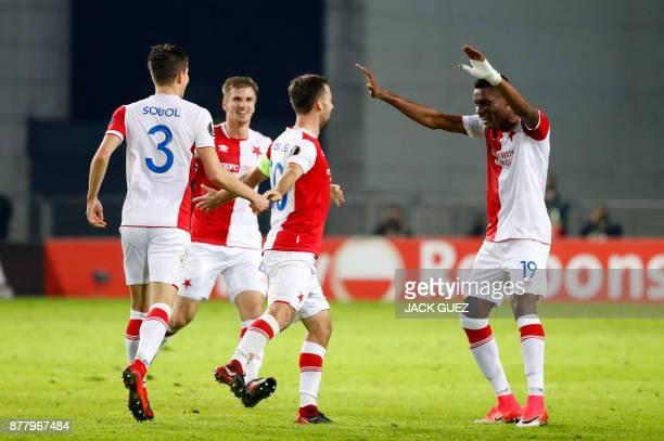 Slavia's Czech midfielder Josef Husbauer celebrates his goal with teammates during the Europa League Group A football match between Maccabi Tel Aviv...