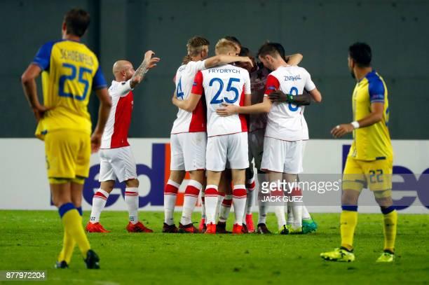 Slavia's players celebrate their second goal during the Europa League Group A football match between Maccabi Tel Aviv and Slavia Prague on November...