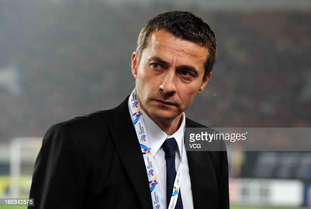 Slavisa Jokanovic head coach of Muangthong United looks on during the AFC Champions League match between Guangzhou Evergrande and Muangthong United...