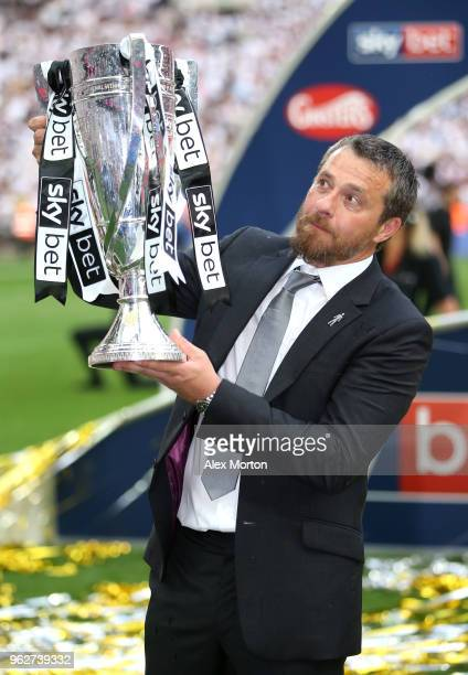 Slavisa Jokanovic Manager of Fulham celebrates with the trophy following his sides victory in the Sky Bet Championship Play Off Final between Aston...
