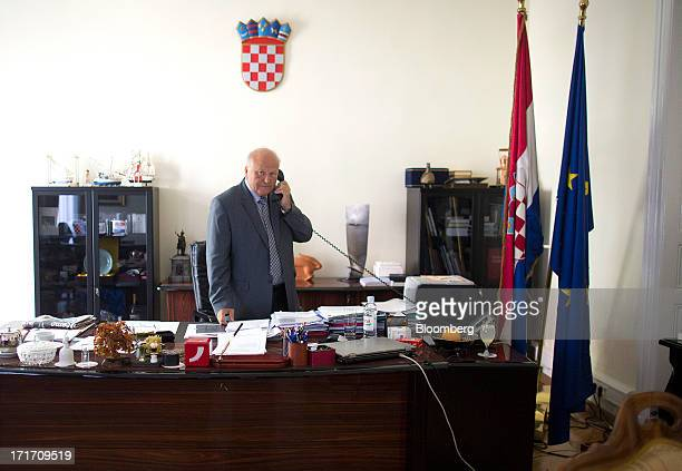 Slavko Linic Croatia's finance minister speaks on the telephone while in his office at the Croatian Ministry of Finance building in Zagreb Croatia on...