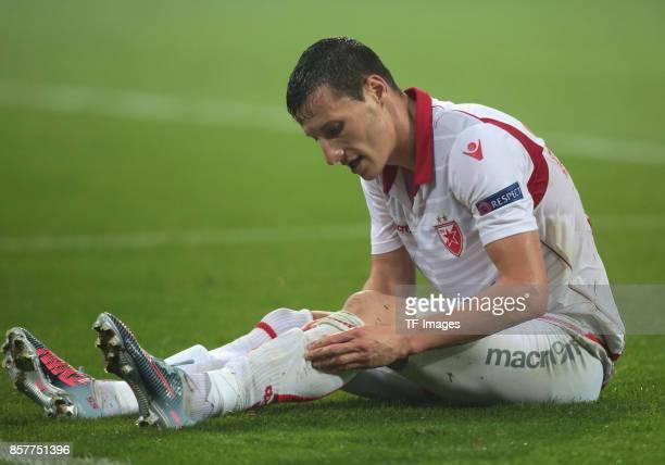 Slavoljub Srnic of Belgrad on the ground during the UEFA Europa League group H match between 1 FC Koeln and Crvena Zvezda at RheinEnergieStadion on...