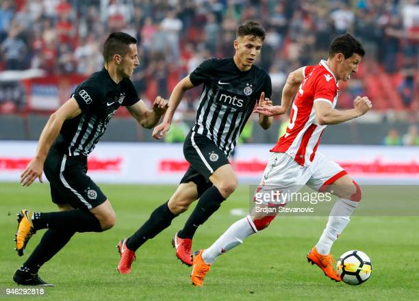 Slavoljub Srnic of Crvena Zvezda in action against Svetozar Markovic and Nemanja Miletic of Partizan during the Serbian Super League Play Off match...