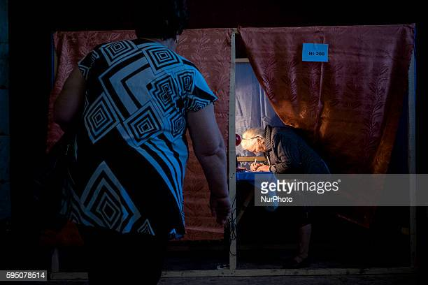 Ukrainians are seen in a voting booth during the referendum called by pro-Russian rebels in eastern Ukraine to split from the rest of the ex-Soviet...
