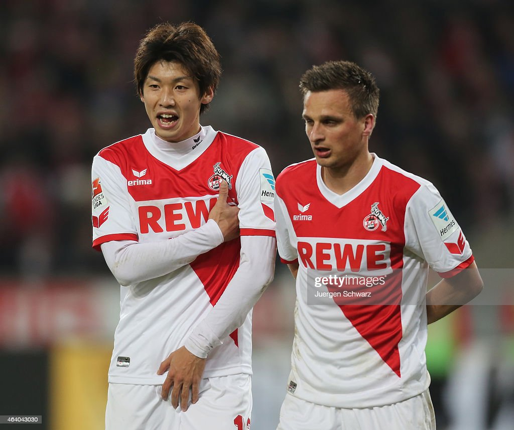 Slawomir Peszko (R) and Yuya Osako of Cologne build a wall during the Bundesliga match between 1. FC Koeln and Hannover 96 at RheinEnergieStadion on February 21, 2015 in Cologne, Germany.