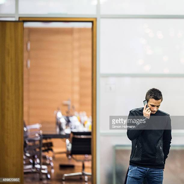Slawomir Peszko of 1 FC Koeln makes a phone call prior to the decision of DFB Court on the objection to the length of a 3 match ban in the DFB Cup...