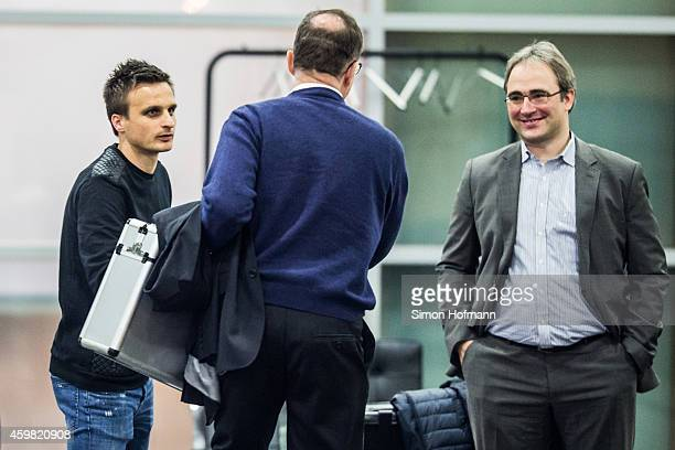 Slawomir Peszko of 1 FC Koeln shakes hands with Hans E Lorenz president of the court prior to the decision of DFB Court on the objection to the...
