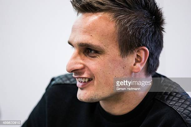 Slawomir Peszko of 1 FC Koeln smiles prior to the decision of DFB Court on the objection to the length of a 3 match ban in the DFB Cup which was...