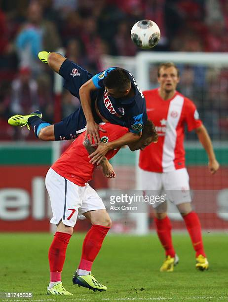 Slawomir Peszko of Koeln is challenged by Niki Zimling of Mainz during the DFB Cup second round match between 1 FSV Mainz 05 and 1 FC Koeln at Coface...