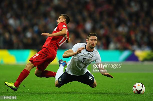Slawomir Peszko of Poland trips Gary Cahill of England during the FIFA 2014 World Cup Qualifying Group H match between England and Poland at Wembley...
