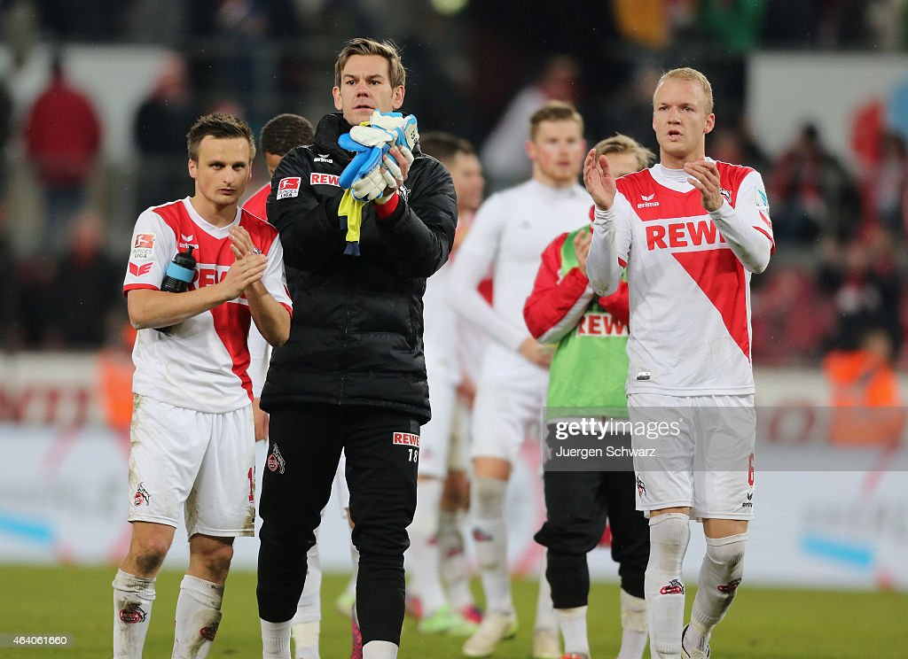 Slawomir Peszko, Thomas Kessler and Kevin Vogt applaud in front of supporters after the Bundesliga match between 1. FC Koeln and Hannover 96 at RheinEnergieStadion on February 21, 2015 in Cologne, Germany.