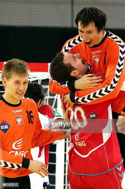 Slawomir Szmal of Poland celebrate with team mate Mariusz Jurkiewicz after the Men's Handball European main round Group II match between Poland and...