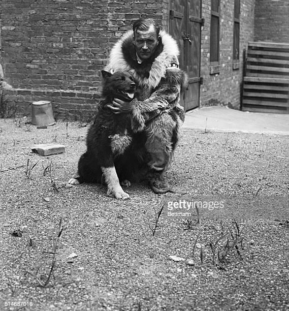 Sledder Gunnar Kasson hugs his famous dog Balto Half wolf half Siberian husky Balto saved many people in Alaska
