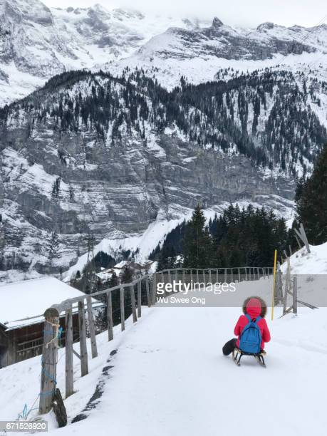 Sledding down from Mürren