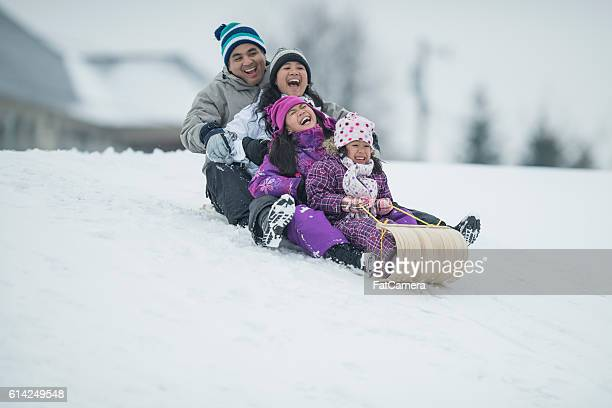 sledding - winter sport stock pictures, royalty-free photos & images