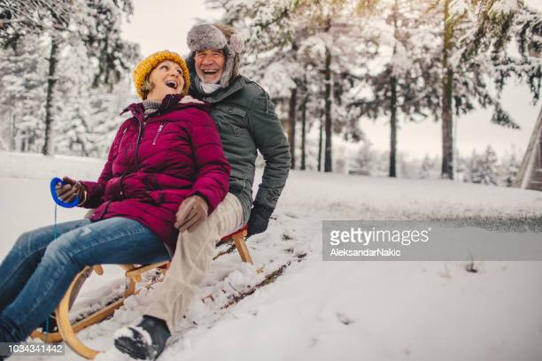 sledding time - winter sport stock pictures, royalty-free photos & images