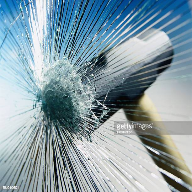 sledgehammer hitting glass - man made stock pictures, royalty-free photos & images