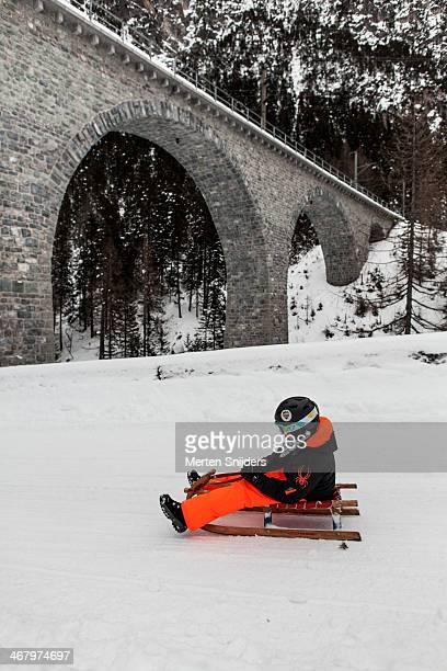 Sledgers sliding down on trail