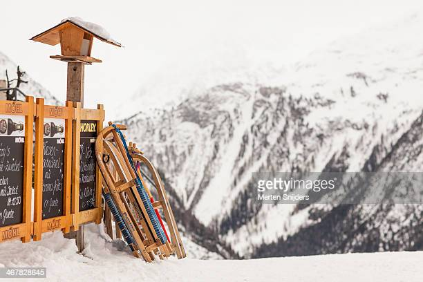 sledges parked at ski restaurant - merten snijders stock pictures, royalty-free photos & images