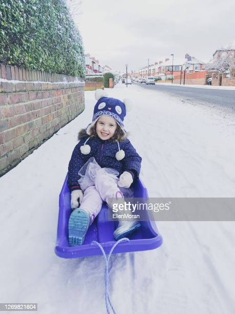 sledging fun - snow boot stock pictures, royalty-free photos & images
