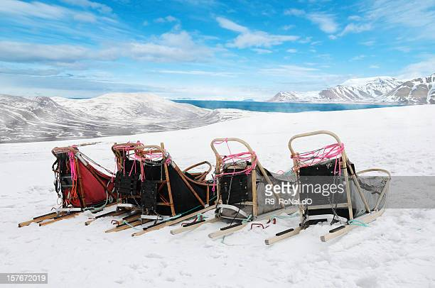 Sleds on snow mountain with blue sky