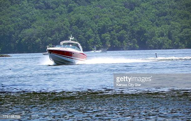 A sleek Formula 400 boat speeds across Lake of the Ozarks