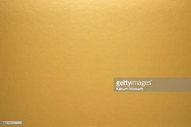 sleek gold paper texture background - gold coloured stock pictures, royalty-free photos & images