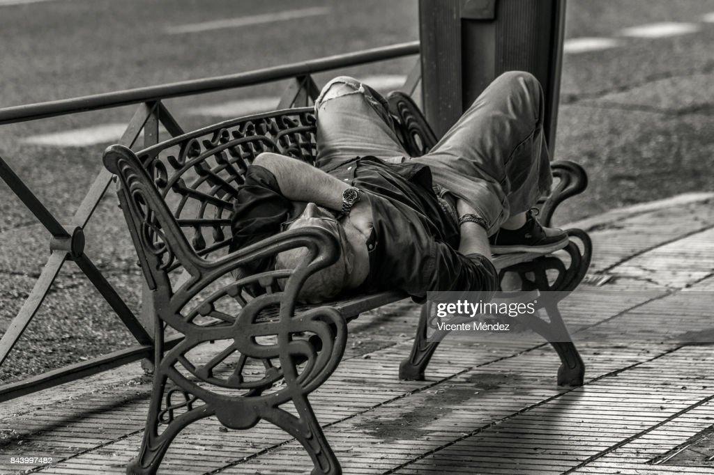 Sleep on a bench : Stock Photo