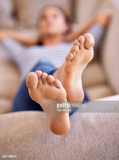 sleep was the only thing on her mind... - female feet soles stock photos and pictures