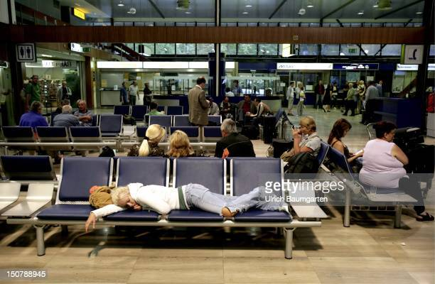 CROATIA ZAGREB Sleeping and waiting passengers in the departure lounge of the airport in Zagreb capital of Croatia
