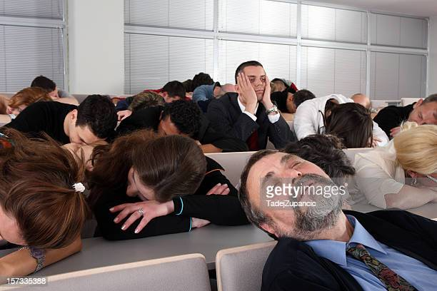 Sleeping audience at a boring business seminar