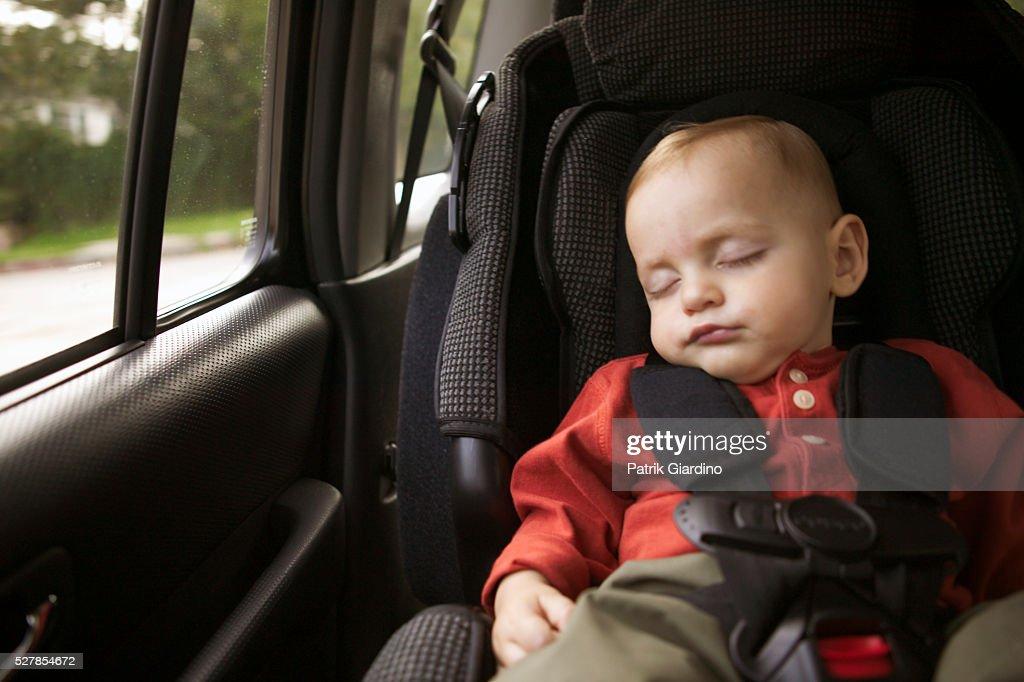 Sleeping Baby In Car Seat Stock Photo