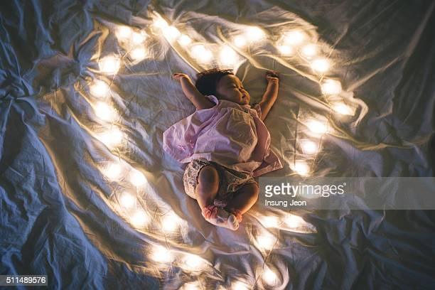 Sleeping Baby In Heart Shaped Fairy Lights