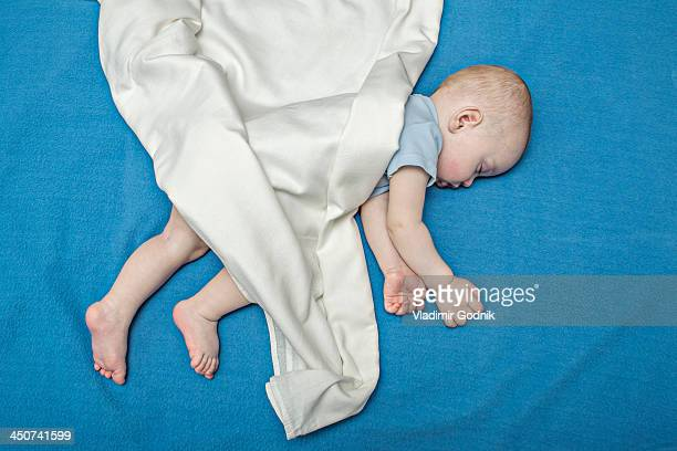 Sleeping baby on blue blanket