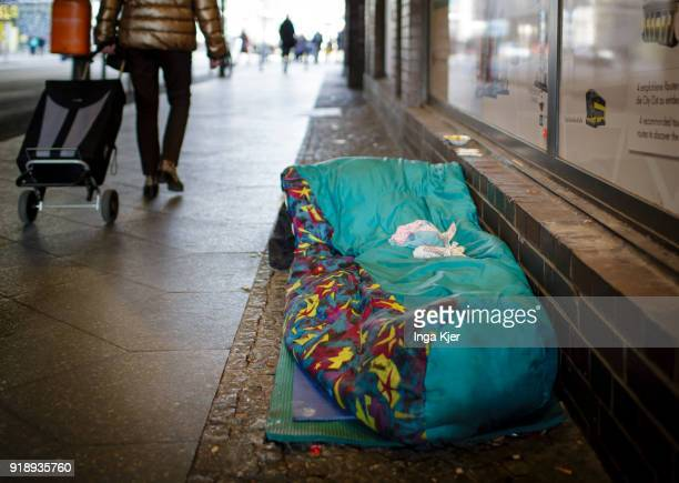 A sleeping bag on which burgers have been put lies on a sidewalk on February 14 2018 in Berlin Germany
