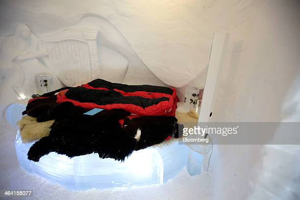 Sleeping bags lay on an ice bed inside a guest bedroom at the igloo hotel operated by IgluDorf GmbH on the Parsenn mountain in this arranged...