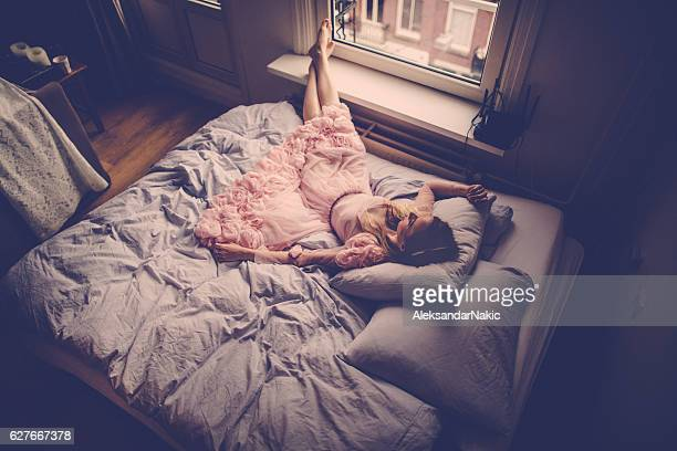 sleeping beauty - pink dress stock photos and pictures
