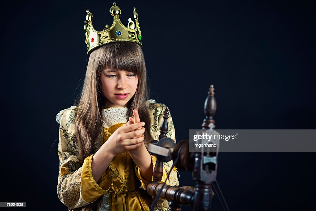 Sleeping beauty pricked finger on spindle : Stock Photo