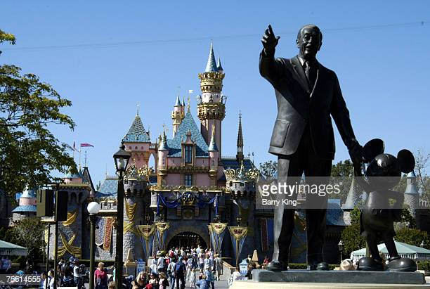 Sleeping Beauty's Castle and statue of Walt Disney and Mickey Mouse at the Disneyland Resort in Anaheim, CA