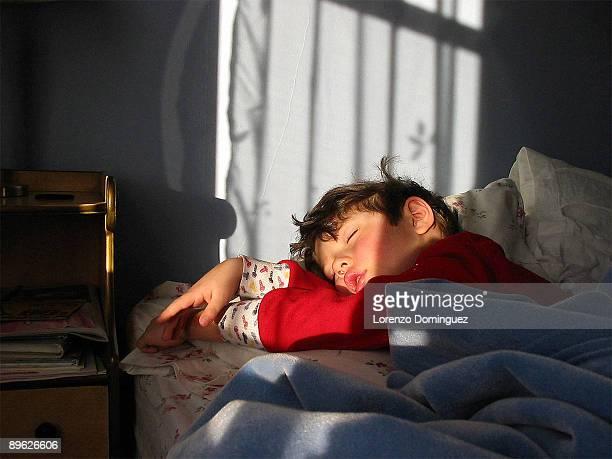 Sleeping boy in red pajamas