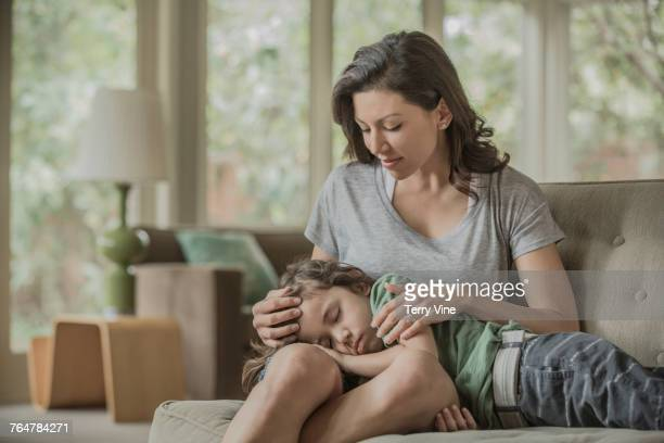 Sleeping boy laying in lap of mother