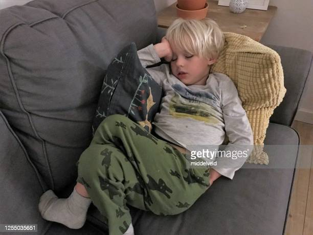 sleeping boy - school detention stock pictures, royalty-free photos & images