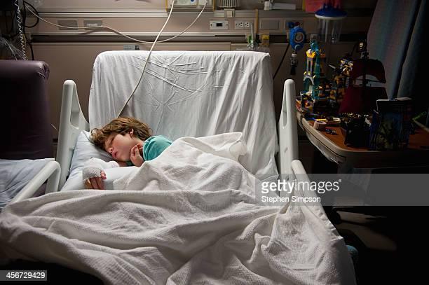 sleeping boy w/toys in hospital burn unit