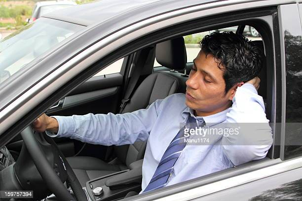 sleeping businessman in a car