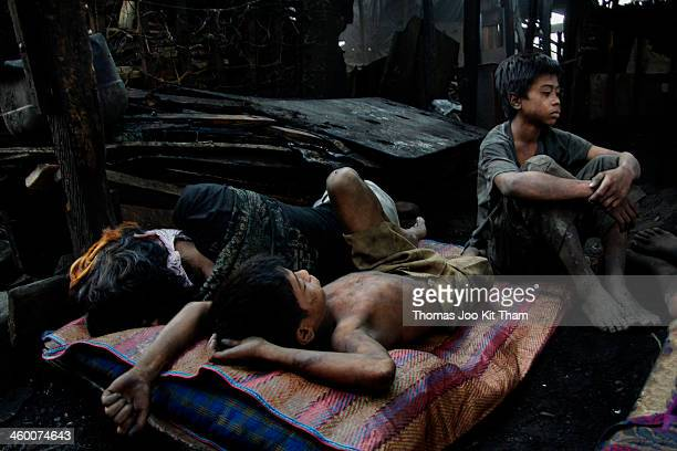 CONTENT] sleeping charcoal boy kid child children labour bed poverty factory Ulingan Manila Philippines dirty injustice