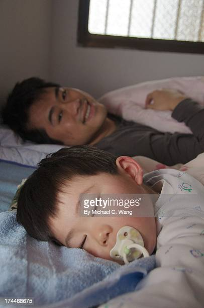 Sleeping Child And Man