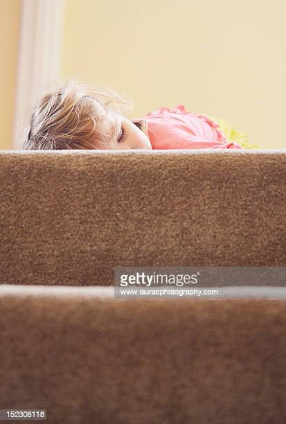 Sleeping child at top of stairs