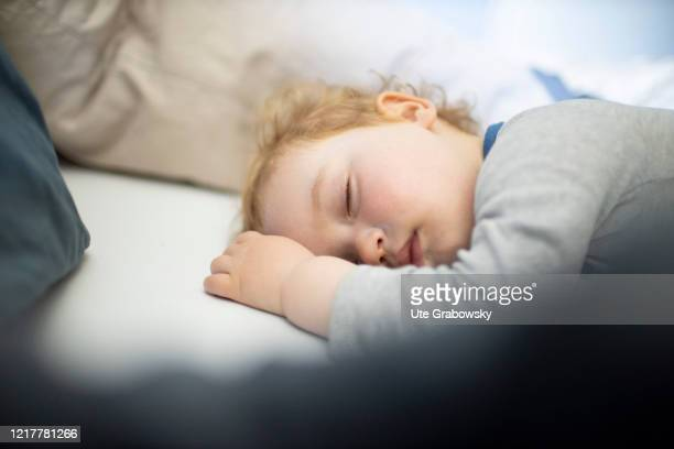 Sleeping child in his parents bed on May 29, 2020 in Bonn, Germany.